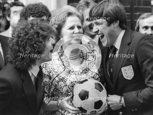 Margaret Thatcher enjoys a joke with Kevin Keegan and Emlyn Hughes, 6th June 1980. Artist: Unknown