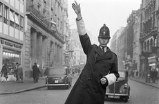 Thumbnail image of An informal portrait of a traffic policeman standing in the road, City of London, c1946-c1959. Artist: John Gay
