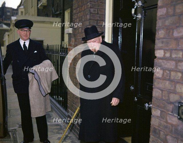 Sir Winston Churchill leaves his Hyde Park home, London, c1955-c1965(?).  Artist: Fox Photos