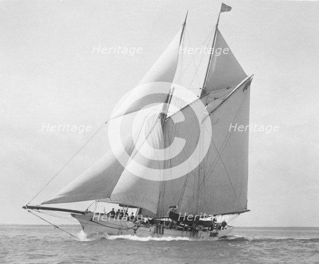 The schooner 'Astria' sailing close-hauled. Creator: Kirk & Sons of Cowes.