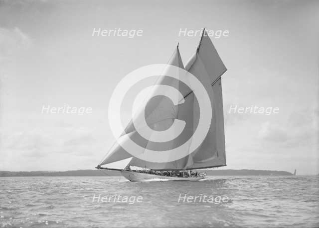 The 250 ton schooner 'Germania' sails close reach, 1911. Creator: Kirk & Sons of Cowes.