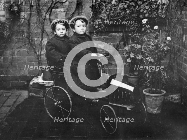 Two boys in a pedal car, (early 20th century?). Artist: Unknown