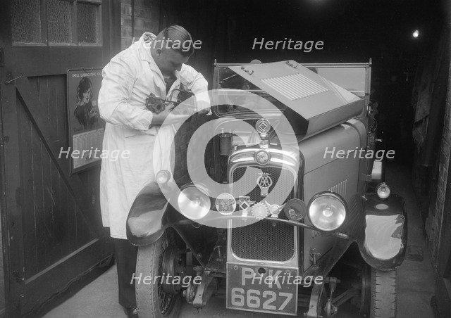 FA Thatcher working on his 1929 Triumph Super Seven. Artist: Bill Brunell.