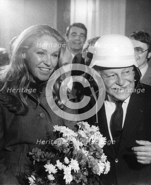 Joan Kennedy with Boston Symphony Orchestra conductor Arthur Fiedler, Bonn, Germany, 1971. Artist: Unknown
