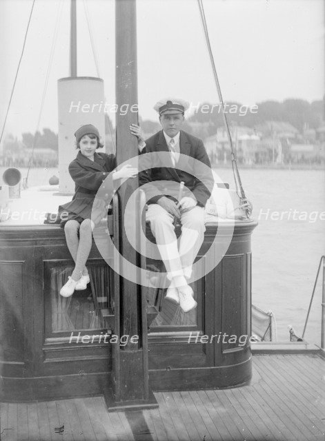 1st Earl of Birkenhead with his daughter on board their yacht, (Isle of Wight?), c1925. Creator: Kirk & Sons of Cowes.