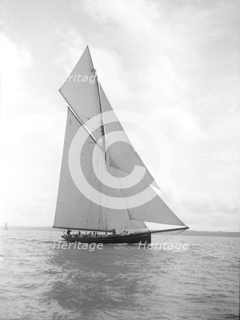 The gaff rigged cutter 'Bloodhound' sailing close-hauled, August 1911. Creator: Kirk & Sons of Cowes.