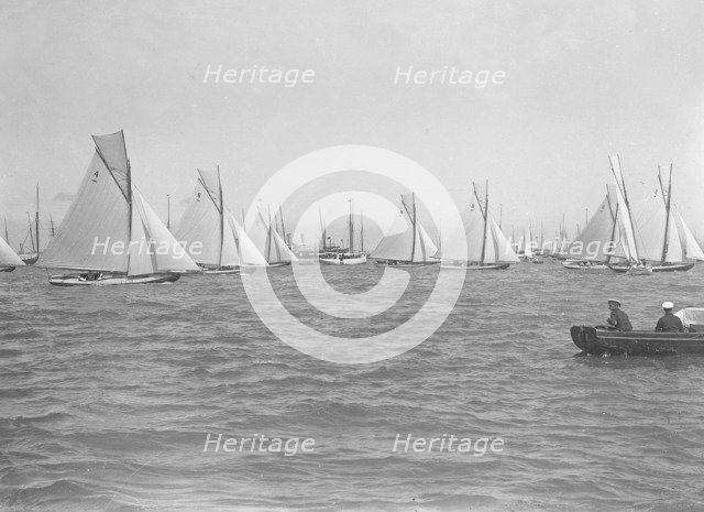 Sailing yachts cross start line. Creator: Kirk & Sons of Cowes.