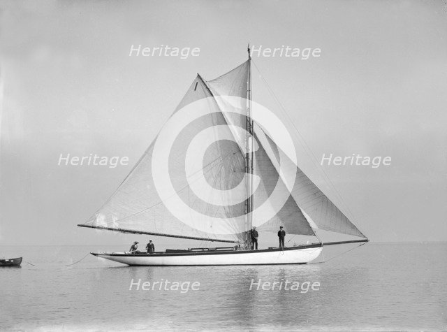 The cutter 'Wenda' in light winds, 1912. Creator: Kirk & Sons of Cowes.