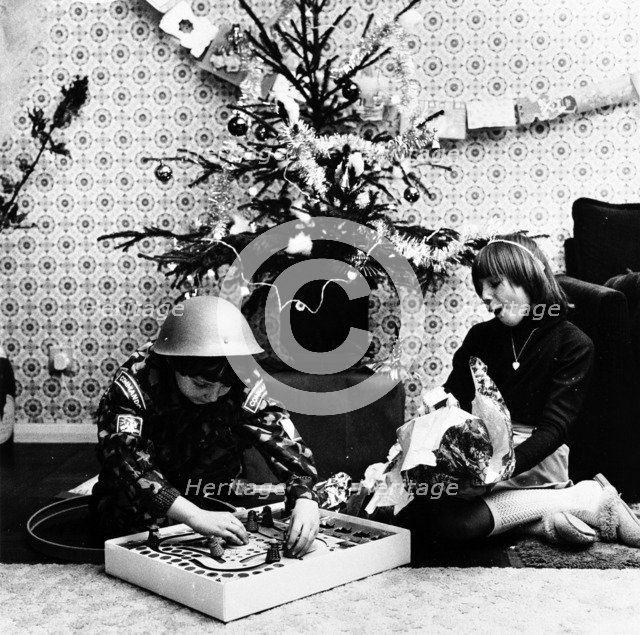Children opening Christmas presents in their London home, c1960s. Artist: Henry Grant