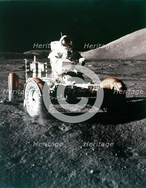 Eugene Cernan using the Rover on the lunar surface, Apollo 17 mission, December 1972. Creator: NASA.