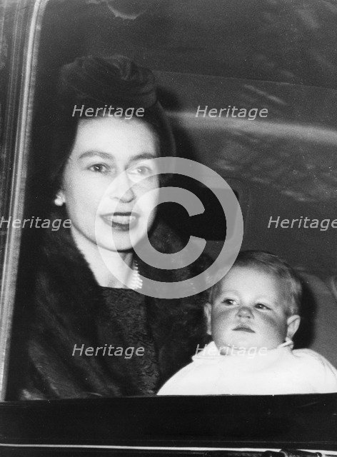 Queen Elizabeth II and Prince Edward in a car on the way to Buckingham Palace, January 1965. Artist: Unknown