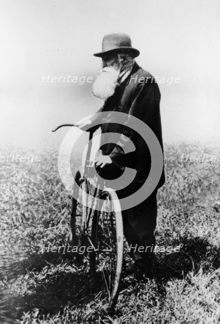 John Boyd Dunlop with bicycle, July 1918. Artist: Unknown