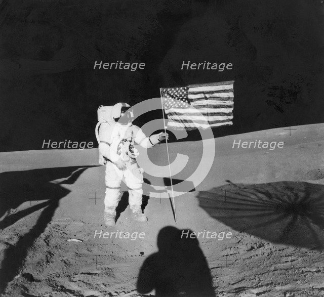 Alan Shepard (1923-1998) planting an American flag during the Apollo 14 mission, 1971. Artist: Unknown