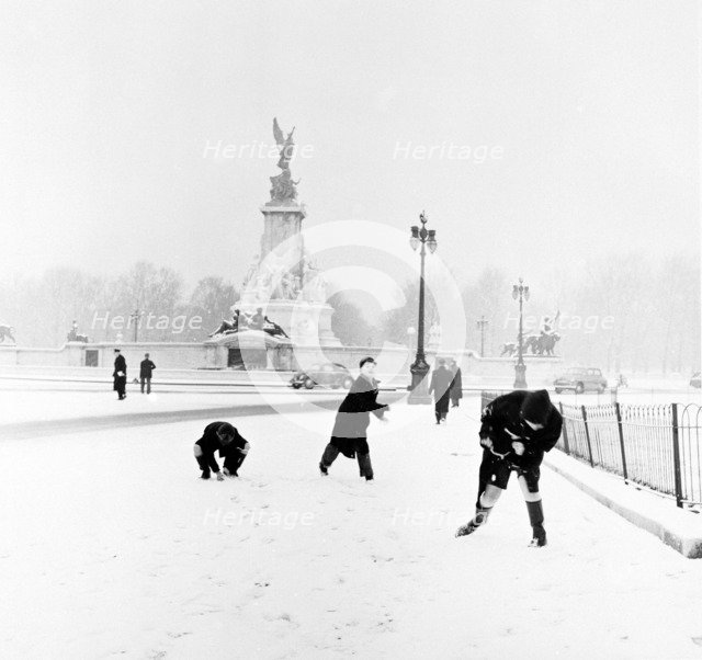 Children playing in the snow, London, 1957. Artist: Henry Grant
