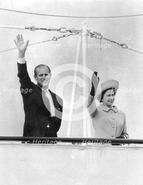Queen Elizabeth II and Prince Philip wave goodbye to France from the yacht 'Britannia', c1960s. Artist: Unknown