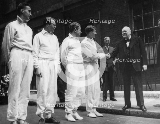 Sir Winston Churchill (1874-1965) shaking hands with Roger Bannister (b1929), c1950s. Artist: Unknown