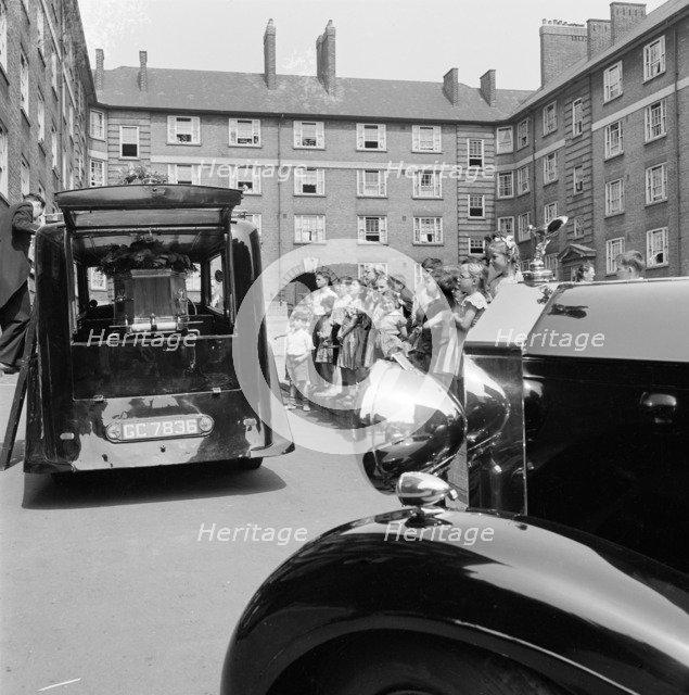 Funeral on a council estate, London, 1960-1965. Artist: John Gay