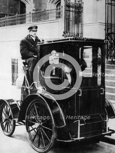 Woman passenger in a 1910 taxi cab, New York, USA, (c1910?). Artist: Unknown