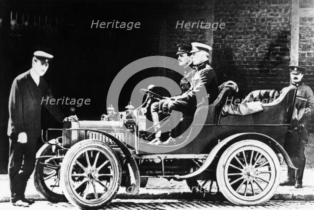 Charles Rolls at the wheel of a 1904 Royce car, c1904. Artist: Unknown