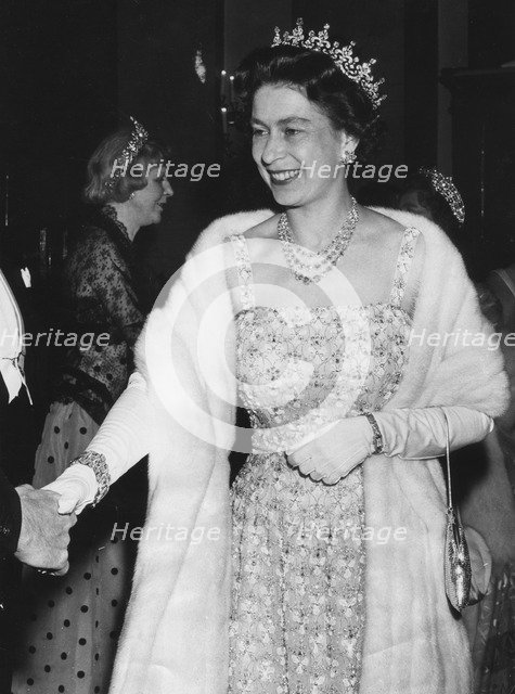 Queen Elizabeth II arriving at the Royal Opera House for a gala performance, Covent Garden, 1965. Artist: Unknown