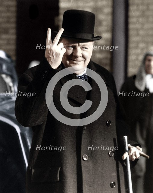 Winston Churchill making his famous V for Victory sign, 1942. Artist: Unknown