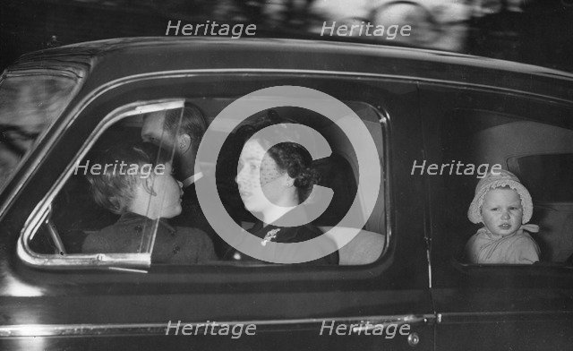 The Royal couple leaving Clarence House for Windsor after George VI's death, 1952. Artist: Unknown