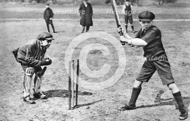 Boys playing cricket in Parliament Hill Fields, London, 1926-1927. Artist: Unknown