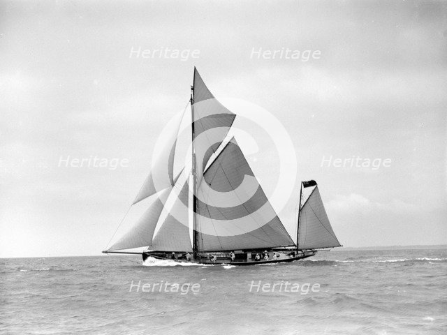The yawl 'Joyce' sailing in good wind, 1911. Creator: Kirk & Sons of Cowes.