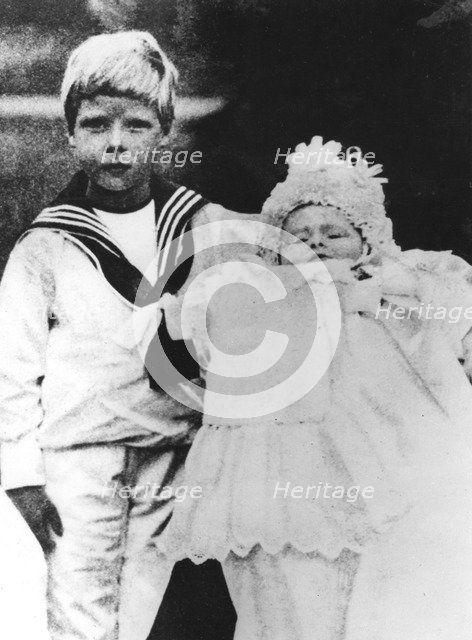The Duke of York with his brother, the Duke of Gloucester, at his christening, 1900. Artist: Unknown