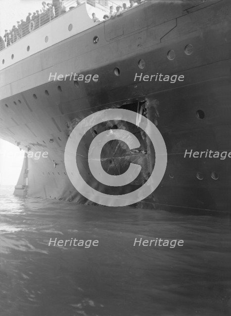 Hole torn in the hull of 'RMS Olympic' after the collision with 'HMS Hawke' in the Solent, 1911. Creator: Kirk & Sons of Cowes.