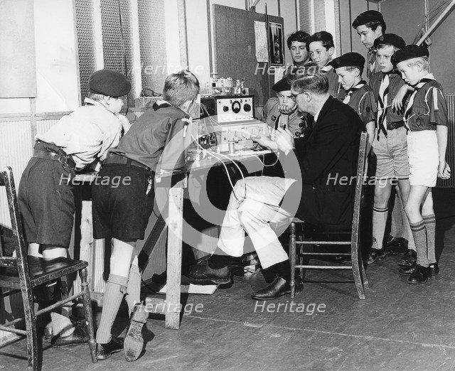 Boy scouts learning radio transmitting, 1960s.