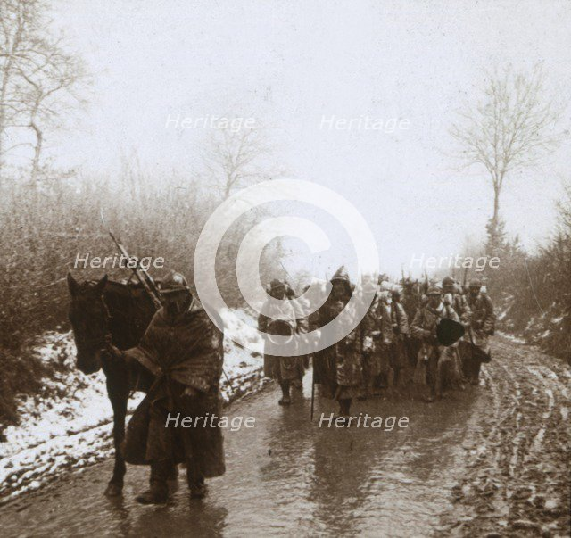 Advancing in the snow, Artois, northern France, c1914-c1918. Artist: Unknown.