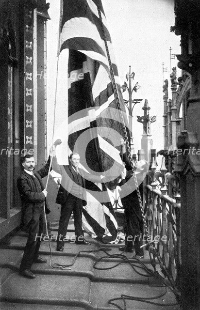 Hoisting the Union Jack, Houses of Parliament, Westminster, c1905. Artist: Unknown