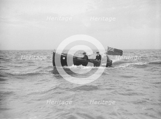 Bona's motor launch under way, 1912. Creator: Kirk & Sons of Cowes.