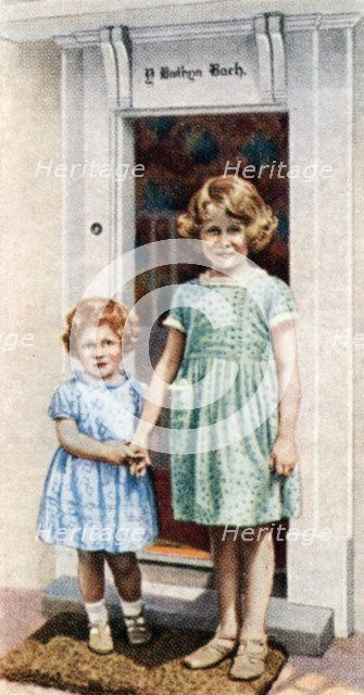 The Princesses Elizabeth and Margaret Rose at the door of the Little House, 1933, (c1935). Artist: Unknown