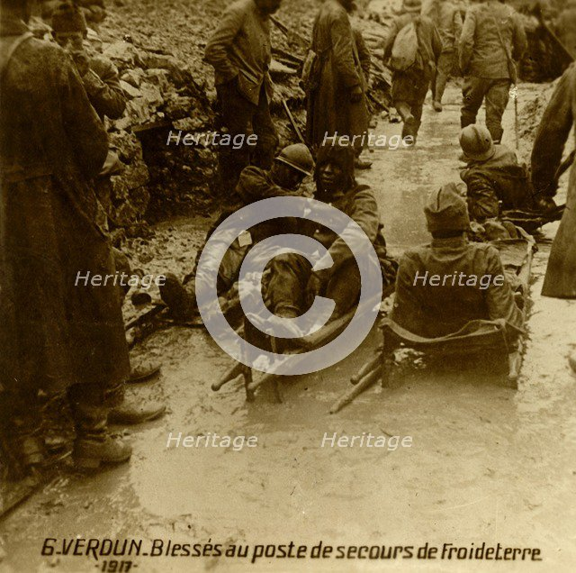 Injured soldiers at the first-aid post, Froideterre, Verdun, northern France, 1917. Artist: Unknown.