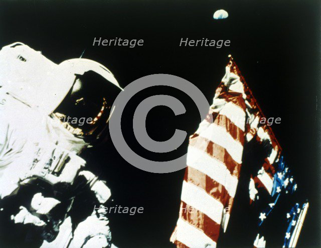 Harrison Schmitt with US flag on the surface of the Moon, Apollo 17 mission, December 1972. Creator: NASA.