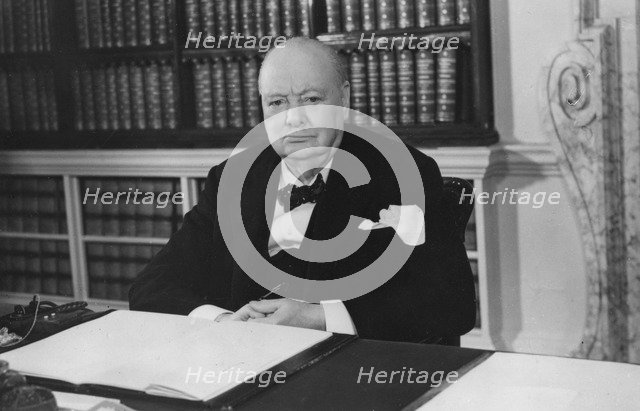 Sir Winston Churchill celebrates his 79th birthday in the Cabinet Room of 10 Downing Street, 1953. Artist: Unknown