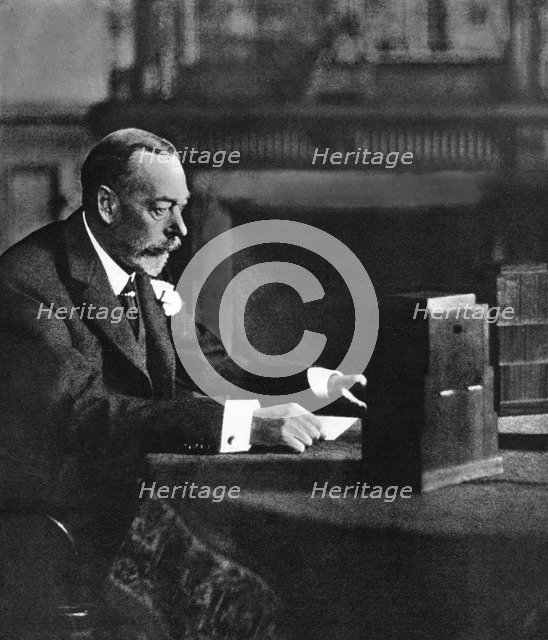 King George V broadcasting to the empire on Christmas Day, Sandringham, 1935. Artist: Unknown
