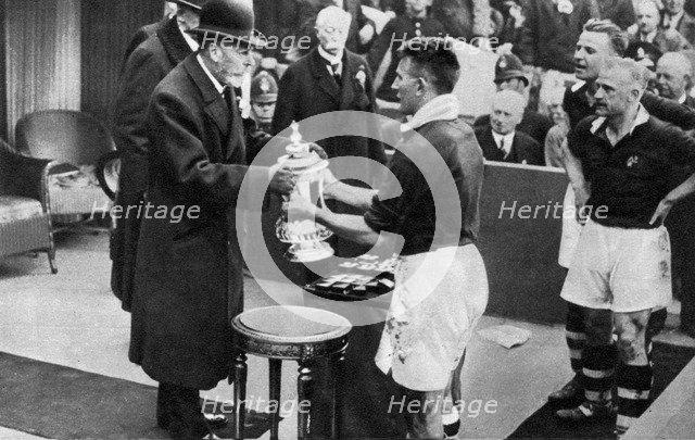 King George V presenting the FA Cup, Wembley Stadium, London, c1923-1936 (1937).Artist: Fox