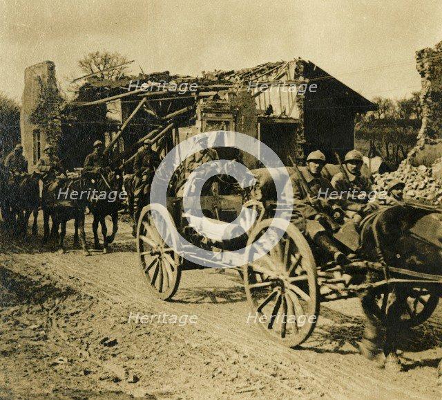 Artillery passing through Beauzée, northern France, c1914-c1918. Artist: Unknown.