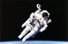 Thumbnail image of US Astronaut Bruce McCandless spacewalking, 1984. Artist: Unknown