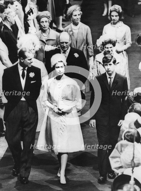 The Queen, Prince Philip, and Prince Charles attending the wedding of Princess Alexandra, 1963. Artist: Unknown